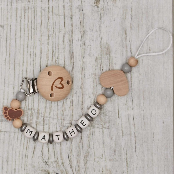 Dummy chain made of wood with with foot and heart