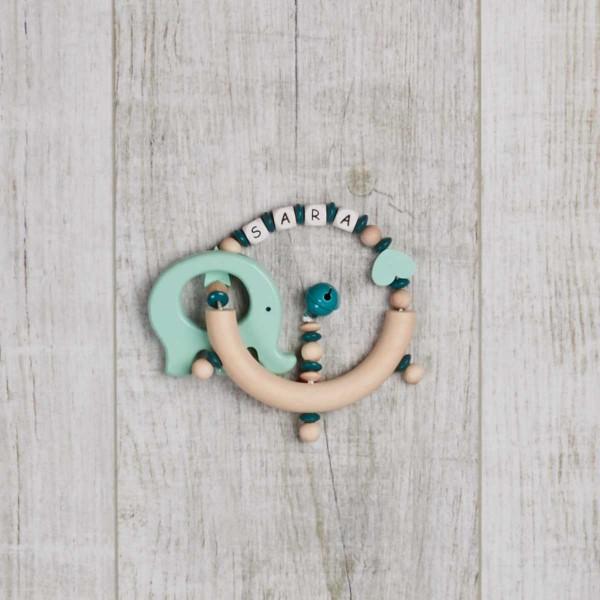 Rassel aus Holz mit Sternchen, Herz und Elefant, mint